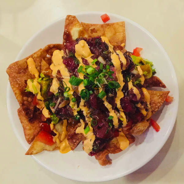Eat a New Food Poke Nachos 2018 Travel New Year's Resolution