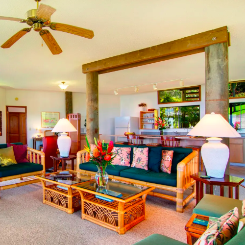 living room with stone pillars and Hawaiian decor
