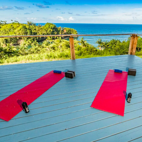 bright red yoga mats with ocean view Airbnbs in Hawaii