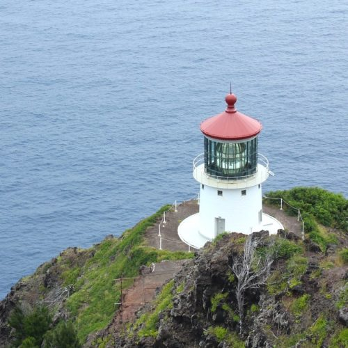 lighthouse with bright red top near ocean easy hikes on Oahu