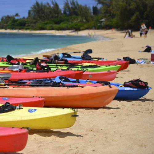 colorful kayaks on beach kayaking on Oahu