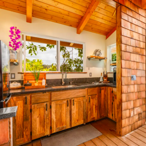 wooden full kitchen in treehouse in Hawaii