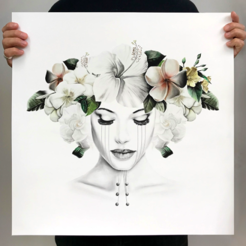 woman with tears on her face and a haku with plumerias and hibiscuses on her head