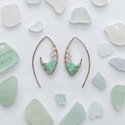 two earrings lined with sea-colored beads and surrounded by sea glass