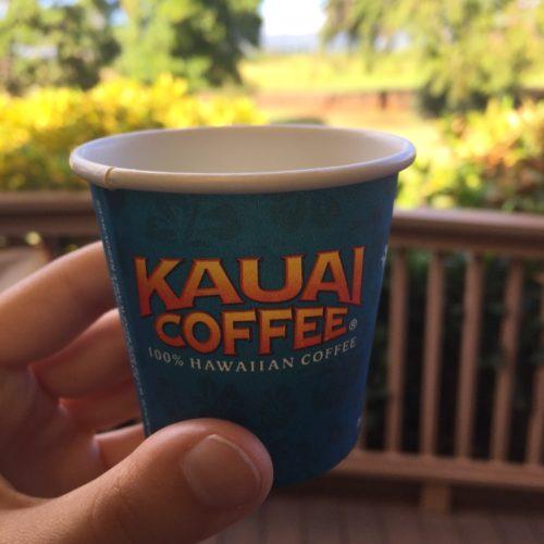 hand holding Kauai Coffee cup Hawaii farms