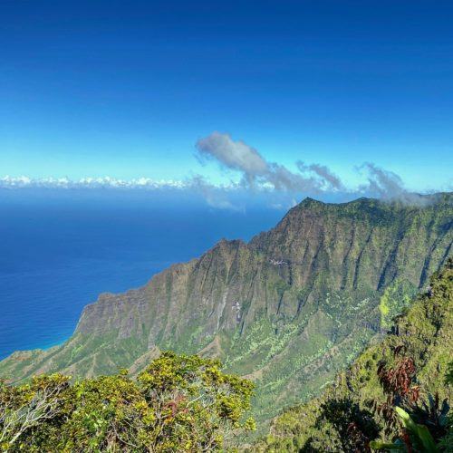 green mountain range in front of ocean Kokee State Park Na Pali Coast things to do on Kauai
