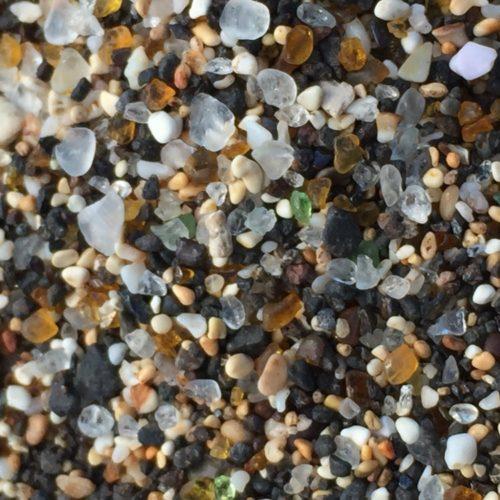 "specks of glass creating ""sand"""