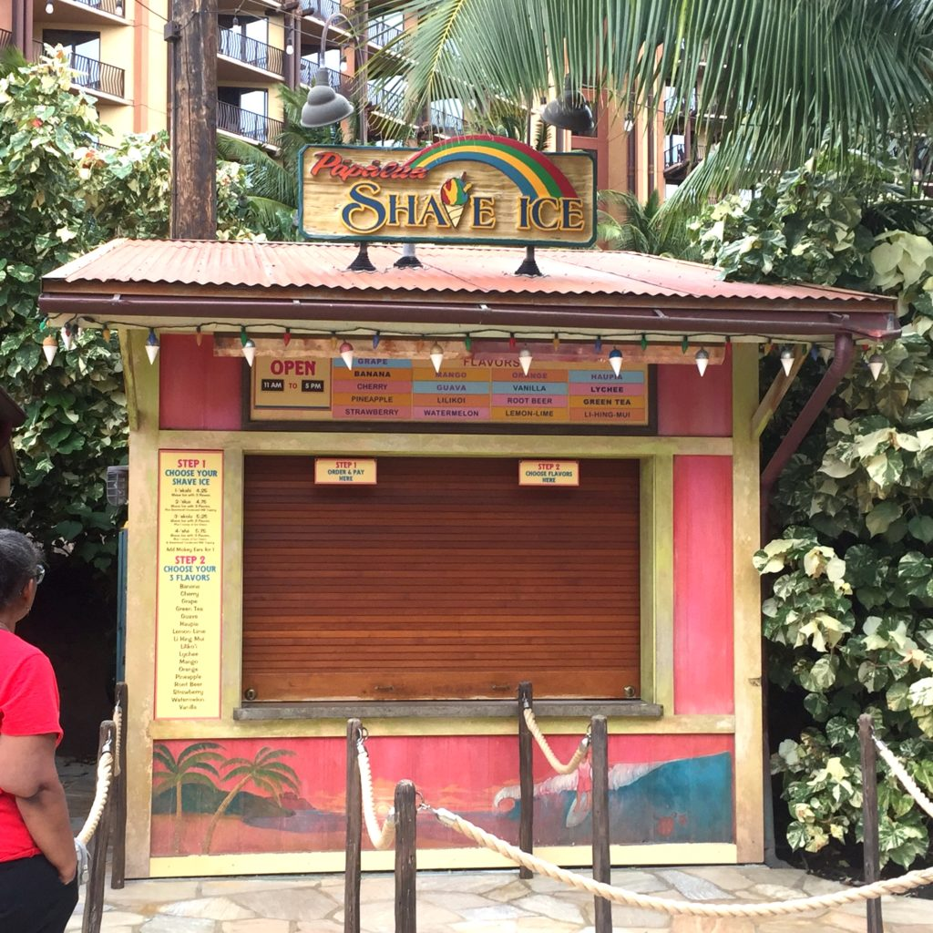 closed red and yellow Hawaiian-style shave ice stand