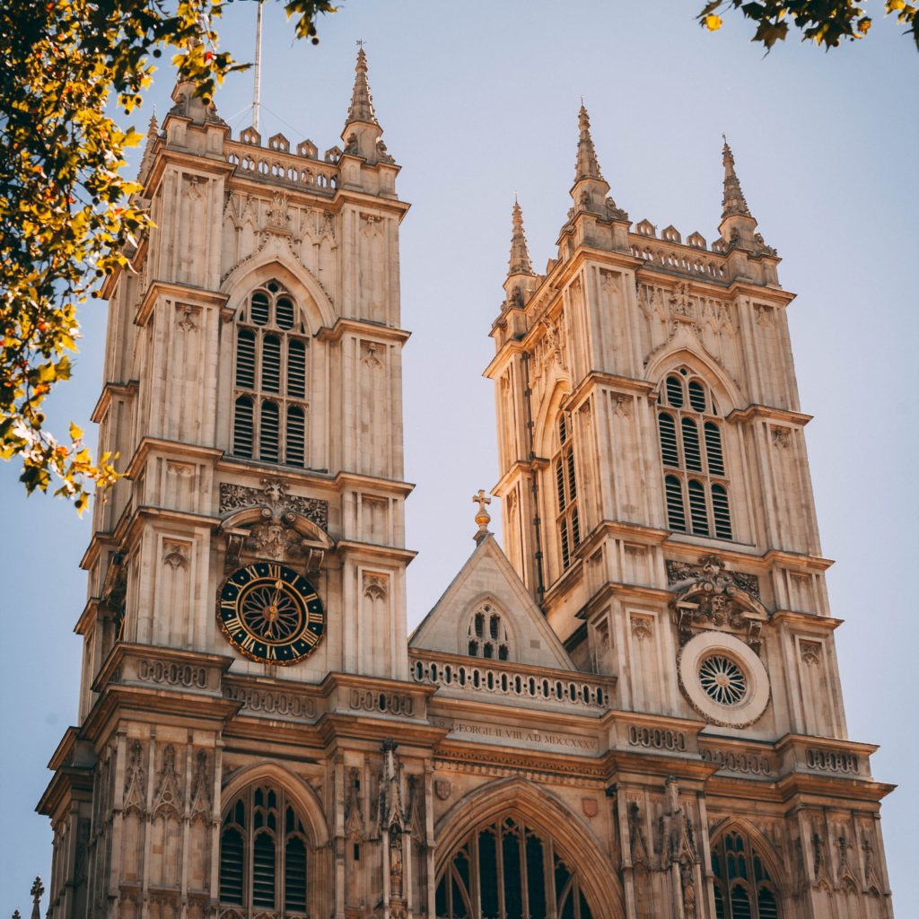 warm photo of Westminster Abbey towers in the fall London bucket list things to do in London